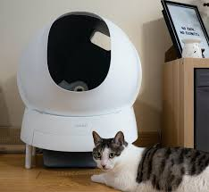 This Self-Cleaning Cat Litter Box Rotates Like a Cement Mixer to ...