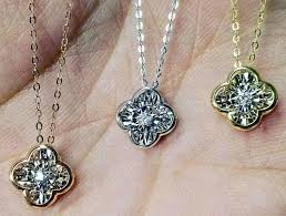 necklace with dancing diamond pendant