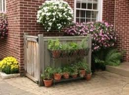 5 Clever Ways To Camouflage Your Ugly Outdoor Air Conditioner