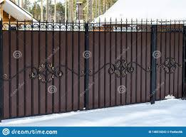 Wrought Iron Fence With A Gate On The Private Sector In A Country House In Winter Snow Stock Photo Image Of Building Brown 148318242
