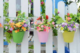 Hanging Flower Pots With Fence Stock Photo Picture And Royalty Free Image Image 18986391