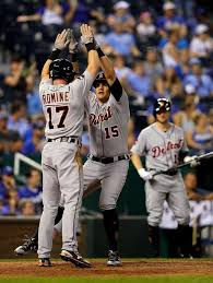 Mikie Mahtook, right, celebrates with Andrew Romine after his two ...