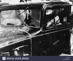 Frank Nash and his police escort are killed in front of Union Railway  Station, Kansas City, 1933. Artist: Unknown Stock Photo - Alamy