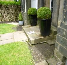 a formal front garden to a period town