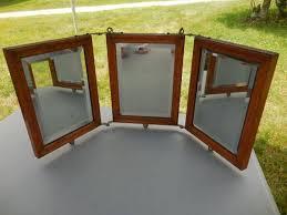 1900s wood framed beveled mirror