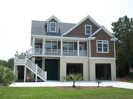 Modern Natural Home Building Materials That Has Brown Exterior Wall Can Add यह Beauty Inside With White Fence Inside यह Modern Natural House Design Ideas That Seems Nice Modern House Exterior Wall