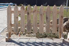 Part Of A Small Wooden Fence With Pegs Close Up Stock Photo Picture And Royalty Free Image Image 107848634