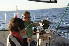 Steering the boat. By Adeline Perry - Picture of On The Wind Sailing  Cruises, New Bern - Tripadvisor