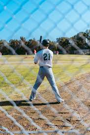 Baseball Player Near Fence Photo Free Human Image On Unsplash