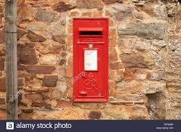 post box in stone wall stock photos