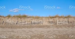 Fencing Between A Beach And Sand Dunes Stock Photo Download Image Now Istock