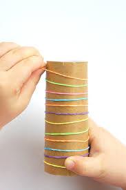 Fine motor cardboard tube challenge for kids - Laughing Kids Learn