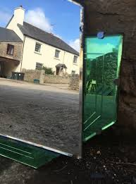 art deco wall mirror with green glass