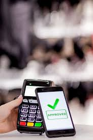 Pos terminal, payment machine with mobile phone on store ...