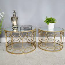 set of 2 round gold coffee tables