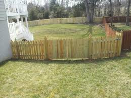 4 High Board On Board Wood Fence With Gothic Pickets And Posts Haymarket Va Beitzell Fence Fencing Companies Wood Fence Fence