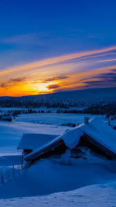 beautiful sunset winter chalet snow