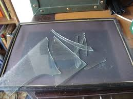 how to dispose of broken glass safely