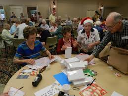 seniors wrap gifts for troops overseas