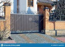 Brown Metal Gates And Brick Fence On The Street Near The Sidewalk Stock Image Image Of Gray Gates 144296219
