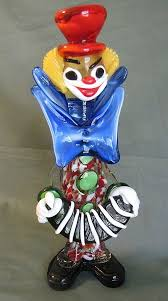 vintage murano glass clown holding an