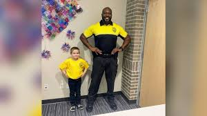 dresses as security officer