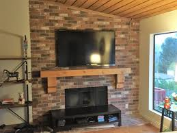 rustic fireplace mantle and flat screen