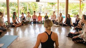 how to travel the world teaching yoga