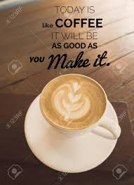 inspirational quote on coffee cup in coffee shop background