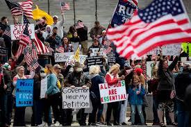 U.S. protesters resist COVID-19 ...