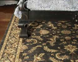 what size rug goes under a queen bed