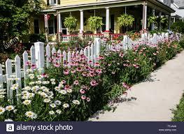Colourful Garden Border Echinacea Path Along A White Picket Fence Stock Photo Alamy