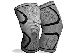 pain relieving knee brace with strap