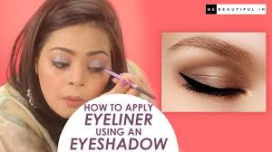 apply eyeliner using an eyeshadow
