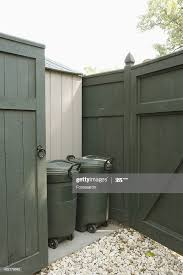 Privacy Fence With Garbage Bins High Res Stock Photo Getty Images