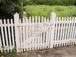 An Old White Picket Fence And Garden Gate White Picket Fence Garden Gates Picket Fence Gate