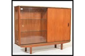 a vintage mid century teak wood display