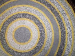 large round gray and yellow crochet rug