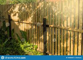 Rustic New Wooden Fence With Black Metal Posts And Gates Garden And Vegetable Garden Fence On A Sunny Summer Day Against The Stock Image Image Of Natural Path 156608281