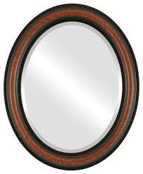 framed oval mirror in vintage walnut