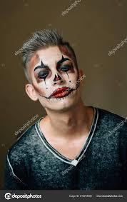 preparation young guy clown makeup