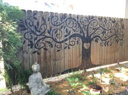 10 Ways To Spruce Your Outdoor Space With Paint Fence Art Garden Fence Art Diy Garden Fence
