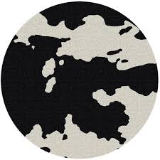 black and white 8 round cowhide rug