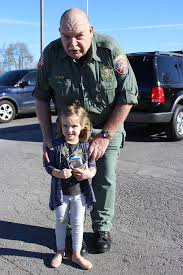 Lt. Joe Gray gave Nola Smith candy. - Rutherford County Sheriff's Office |  Facebook