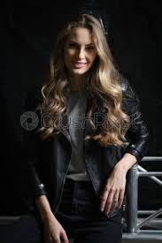 long curly hair in black leather jacket