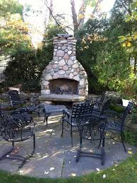 river rock outdoor fireplace