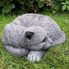 onefold curled up cat hand cast stone