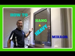 how to hang a heavy mirror you