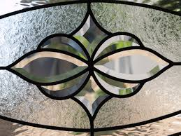 how beveled glass is made and used