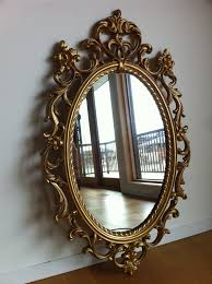 hollywood regency syroco gold mirror